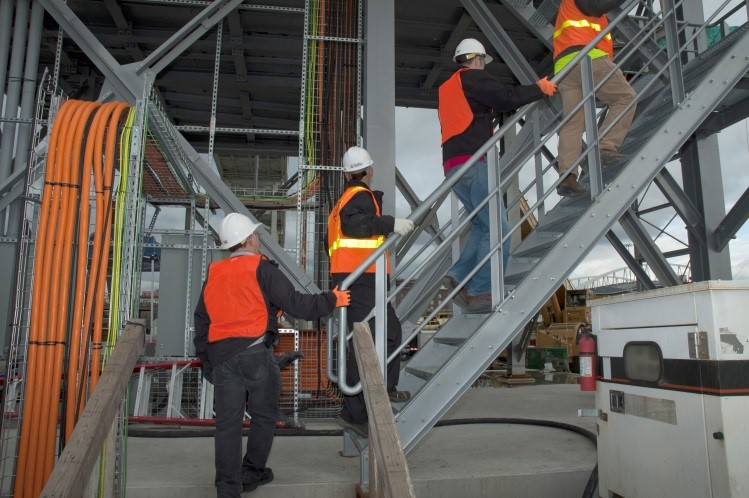 Photo of workers climbing stairs