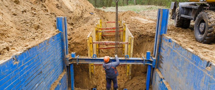 Image of construction workers doing trenching work